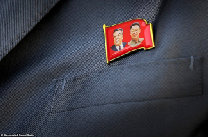 The pin of Kim Il-sung (grandfather), and Kim Jong-un's deceased father, Kim Jong-il, is to be worn by every citizen while in public (who is 16 years of age and older). Most children also wear the pin.